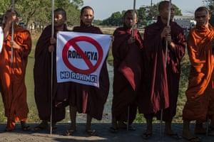Buddhist monks and other anti-Rohingya supporters rally outside Yangon's Thilawa port