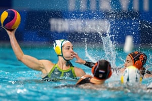 Australia's Keesja Gofers is challenged by Nomi Stomphorst of the Netherlands during the women's preliminary round of water polo.
