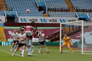 Hause heads back across goal.