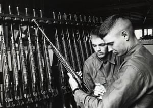 Phil and Don at a rifle rack during their military service