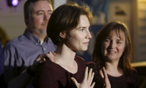 Amanda Knox (centre) talks to the press following the court ruling.