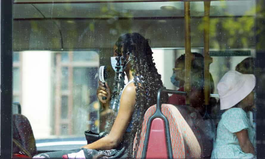 Passenger with fan on London bus