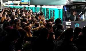 Commuters stand on a platform at Saint-Lazare subway station as the strike continues.