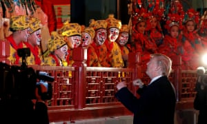 Donald Trump talks to opera performers at the Forbidden City in Beijing.