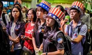 People in Ho Chi Minh city, Vietnam, watch the US presidential election results as they come in.
