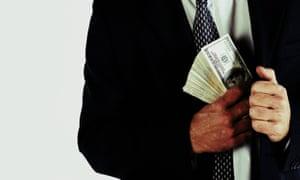 Man putting stack of dollar bills in pocket