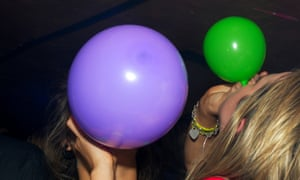 Balloons of nitrous oxide are consumed at a party