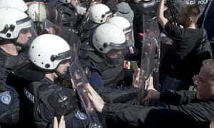 Riot police and protesters in Belgrade