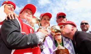 Strapper Stephen Payne (left) and his jockey sister Michelle Payne celebrate winning the Melbourne Cup