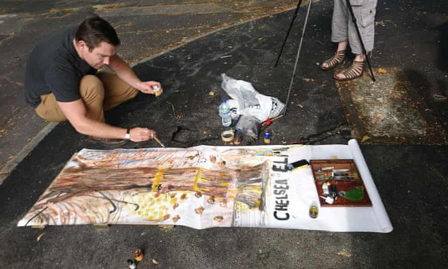 Dan Llywelyn Hall painting a tree on Chelsea Road, Sheffield, also planned to get chopped down as part of the Amey deal.