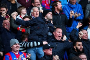 Palace fans celebrate as their side take a 2-0 lead before half-time