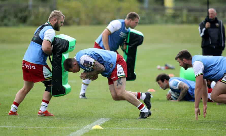 Teimana Harrison charges into a tackle bag during a Northampton Saints training session at Franklin's Gardens in July.