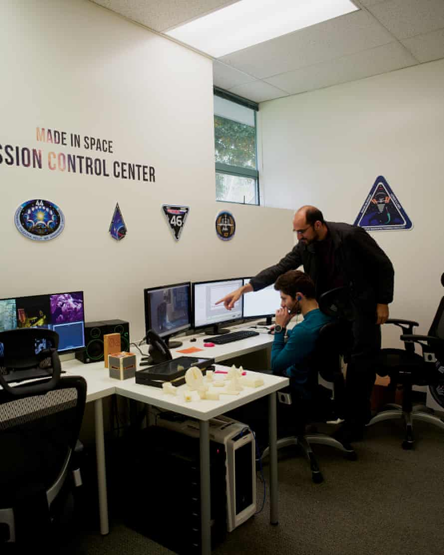 Matthew Napoli and Dylan Tepper inside the mission control room that digital print files are sent to the space station from.