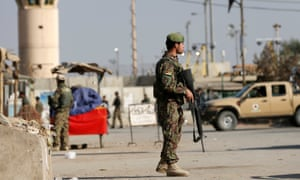 Afghan National Army soldiers keep watch outside the Bagram airfield entrance gate following the attack.