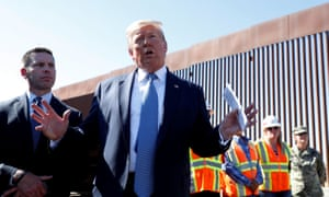 Trump visits a section of the U.S.-Mexico border wall in Otay Mesa, California.