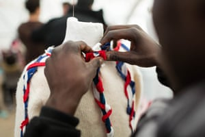 Nouredine, a Sudanese refugee, works on the intricate detailing for his first creation