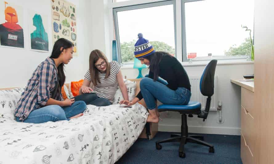Three young women in university room