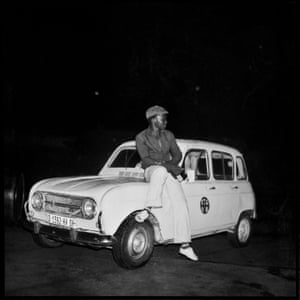 La 4L et son maître, 1970 This is a shadow taxi driver – an unlicensed black cab, a waiting for potential customers outside of a dancing place. He was a friend of my younger brother Bamoussa.