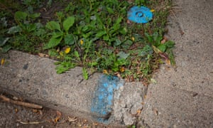 The Detroit water and sewerage department marks the curb in front of houses whose water it has shut off, including this house in Detroit's North End neighborhood.