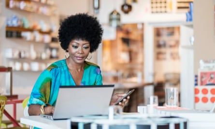 Black business owner at her laptop in her shop.