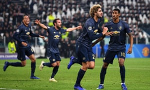 Marouane Fellaini leads the celebrations after Alex Sandro's late own goal earned Manchester United a dramatic comeback win in Turin.
