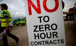 Protester holds a sign that reads: 'No to zero hours contracts'