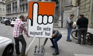 A sign reading 'vote today' in Fribourg. Switzerland has held about 300 referendums since 1848.