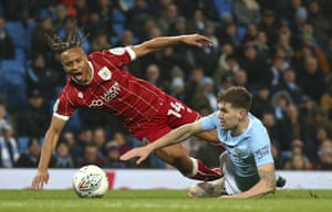 John Stones brings down Bobby Reid for the penalty that the Bristol City forward scored to put the Championship high fliers ahead.