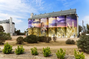 The artist Cam Scale painted the Viterra grain silos in Kimba in South Australia in 2017 over 26 days. Scale's 60 metre-wide mural depicts a girl standing in a wheat field that blends into the real thing behind the working silos