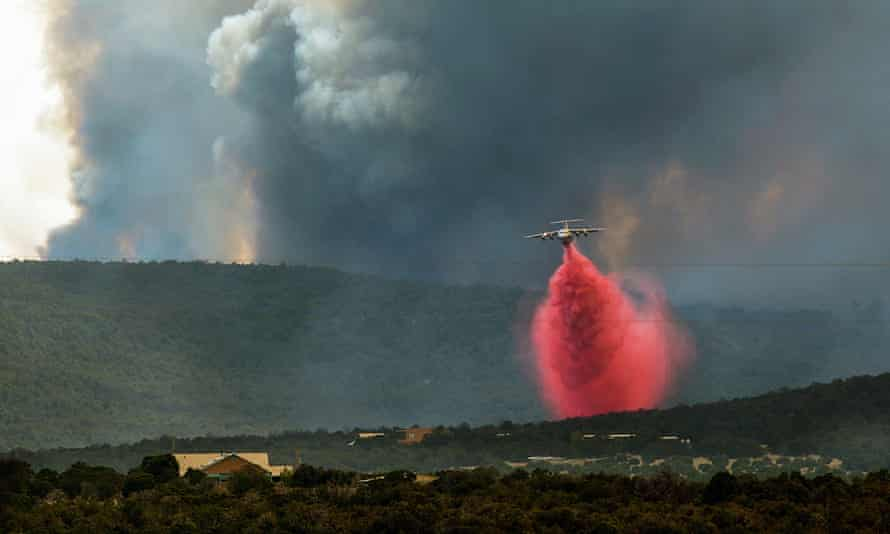 A fire fighting tanker drops retardant on the Dog Head Fire in Albuquerque, New Mexico.