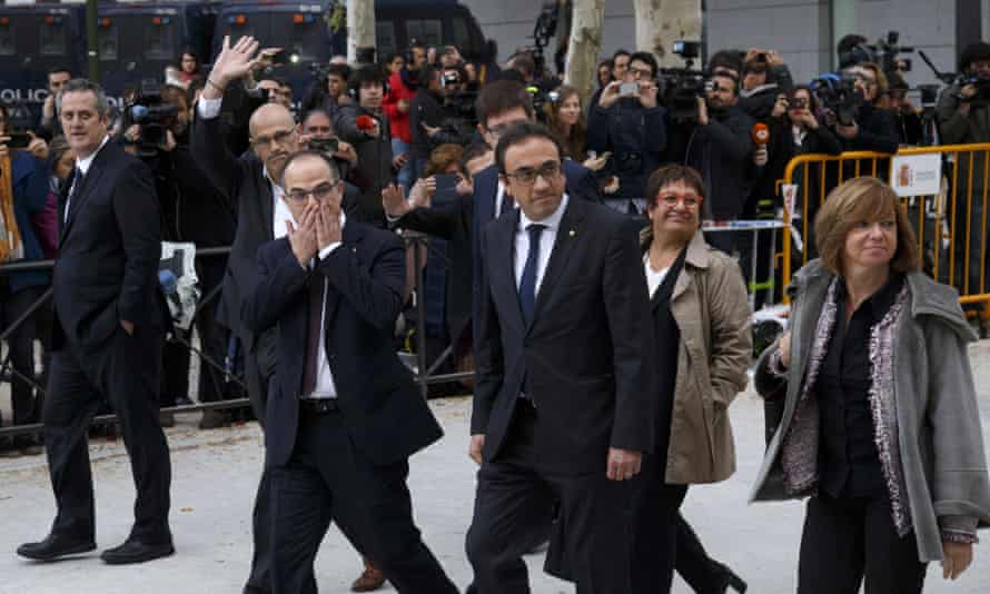 Former members of the Catalan government arrive at Spain's national court in Madrid.