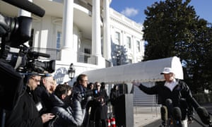 Trump at the White House. Democrats say the wall is a waste of money, and have accused Trump of using rhetoric 'full of misinformation and even malice'.