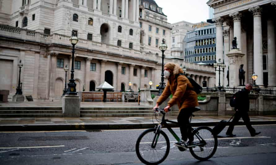 A cyclist rides past the Bank of England in central London during the second wave of the pandemic.
