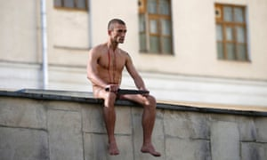 Petr Pavlensky sits on the Serbsky psychiatric centre after severing his right earlobe.
