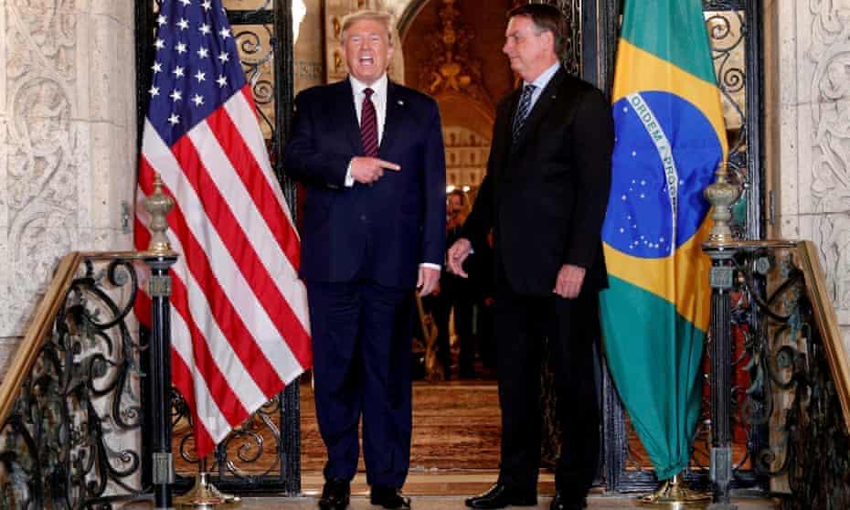 Jair Bolsonaro, right, revels in his image as a 'Tropical Trump'.