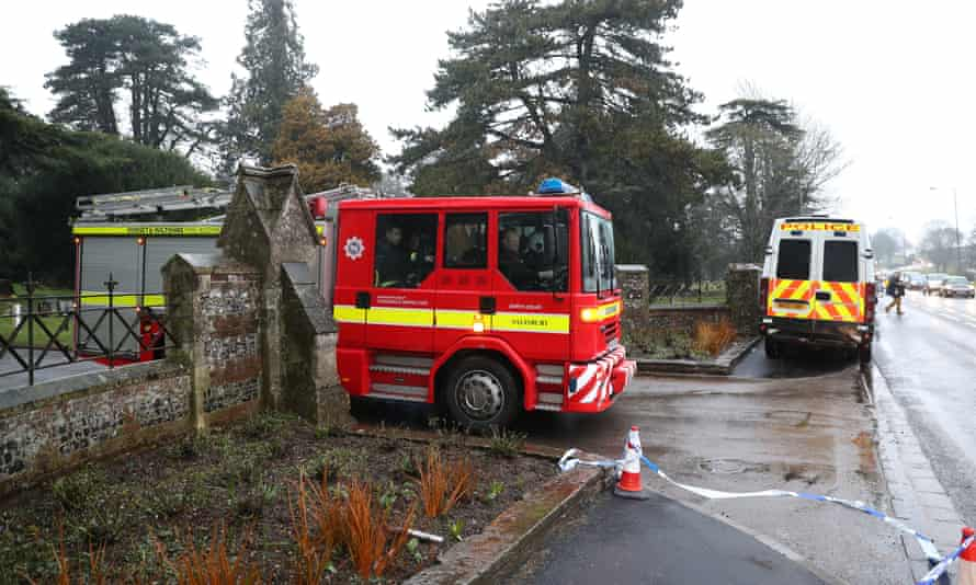 A fire engine leaves the London Road cemetery in Salisbury, Wiltshire.