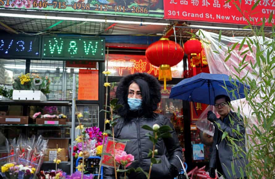 A woman wears a face mask in New York City's Chinatown on 13 February.