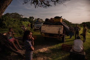 PARMANA, VENEZUELA Mayerlin Barasalte and her sister wait for fishermen to return with the catch of the night. The town depends almost entirely on fishermen for food. @ Adriana Loureiro Fernandez / The New York Times
