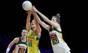 Liz Watson of Australia and Karla Pretorius battle for possession.