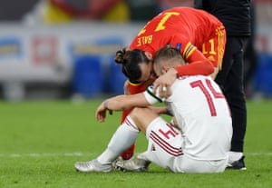 Gareth Bale comforts a dejected Gergo Lovrencsics.