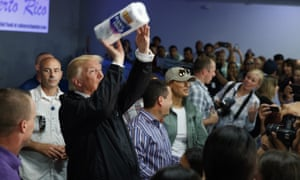Donald Trump tosses paper towels into a crowd at Calvary Chapel in Guaynabo, Puerto Rico.