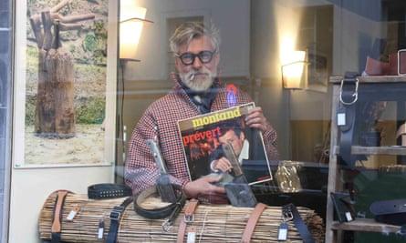 Pierre in windown of vinyl office