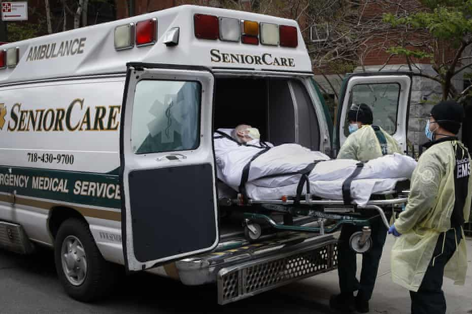 A patient is loaded into an ambulance at Cobble Hill Health Center in Brooklyn, New York.
