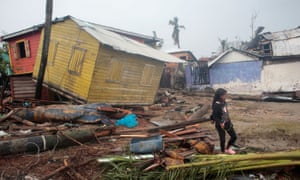 A girls walks past houses destroyed by Hurricane Iota, in Puerto Cabezas, Nicaragua.
