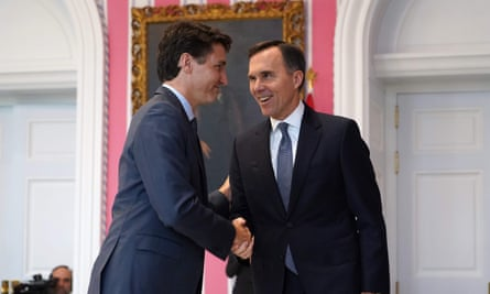 Canadian Prime Minister Justin Trudeau shakes hands with Minister of Finance Bill Morneau