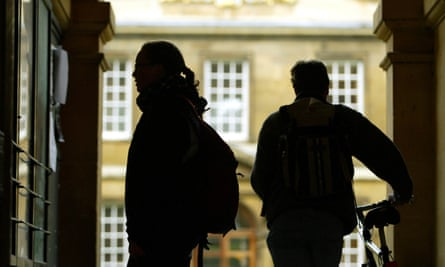 Students arrive for lectures at Trinity Hall, Cambridge