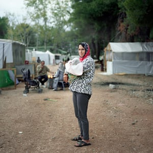 Ritsona, Chalkida, Greece 2016 Misgin Abdulah, a 33-year-old mother of three, poses with her eight-day-old baby.
