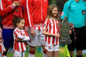 One of Stoke City's mascots gives the eye to the other holding a replica FA Cup trophy. Stoke lost the Game 2-0 to Championship side Wolverhampton Wanderers.