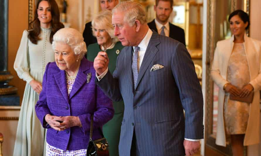 Prince Charles leads the way along with the Queen at Buckingham Palace in 2019