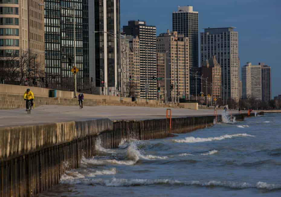 The wind whips up small waves near a cycle path alongside Lake Michigan in Chicago.